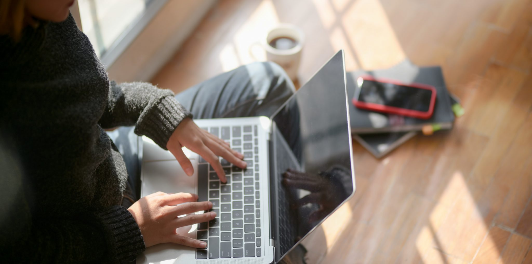 woman-in-gray-sweater-typing-on-laptop-3759059